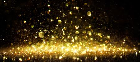 Shimmer Of Golden Glitter On Black Banque d'images