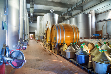 Steel Tank, Barrels And Carboy In Modern Winery Factory