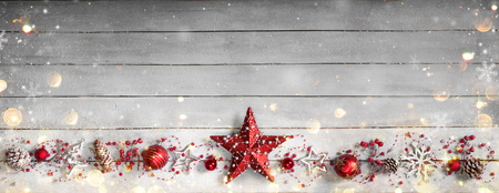 retro background: Christmas Ornament In Row On Vintage Wooden Plank