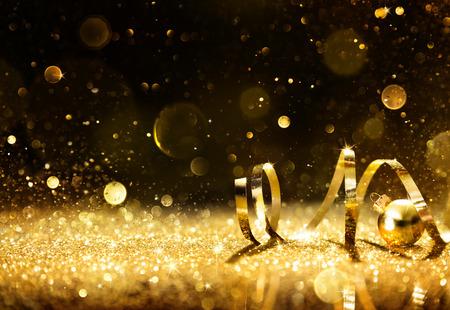 慶典: 金色飄帶閃閃發光閃光