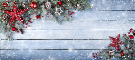 fir: Christmas Fir Tree On Wooden Background With Snowflakes