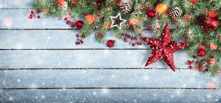 Fir Tree and star On Wooden Background With Snowflakes And Lights Stock Photo