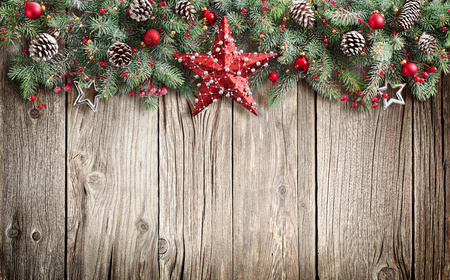 Christmas Fir Tree Decorated On Wooden Background Stock Photo