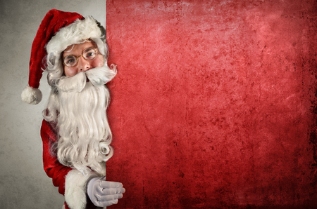 christmas poster: Santa Claus Showing Behind Of red Billboard