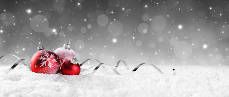 christmas bauble: Red Baubles On Snow With Sparkling Stars On Silver Background