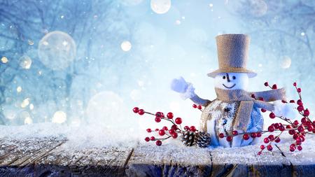 Snowman Greets Happy Under Snow Stock Photo