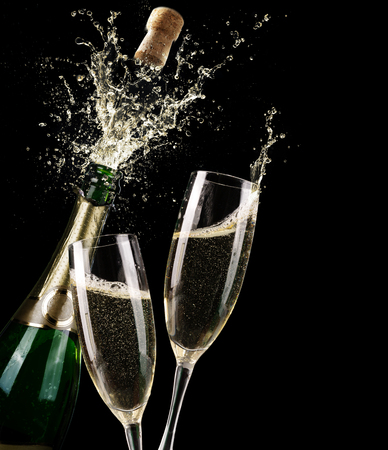 champagne glasses: Popping Champagne And Toast Of Midnight Stock Photo