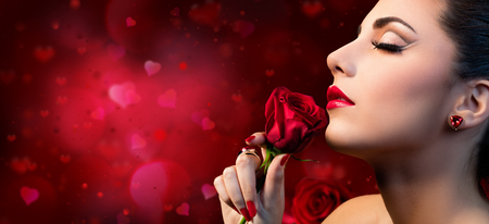 kissing lips: Valentines Beauty - Sensual Model Woman Touching Red Rose Flower