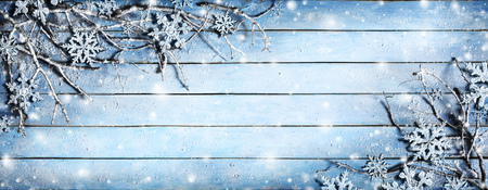 white back: Winter Background - Snowy Branches On Plank With Snowflakes