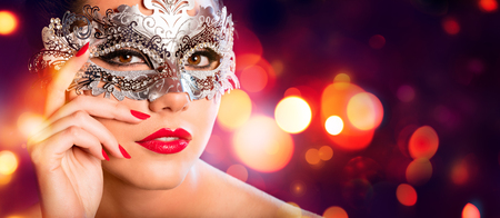 sexy glamour model: Sensual Woman With Carnival Mask - Red Golden Background