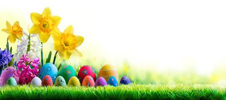 light color: Daffodils Hyacinths And Decorated Eggs On Green Meadow - Easter Holiday Background