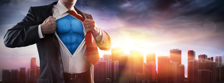 Businessman Superhero With Sunset In City Banque d'images