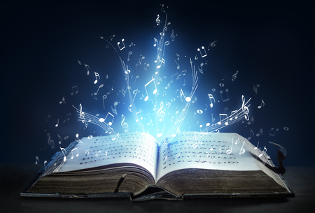 songs: Classical Symphony Shines With Musical Notes From An Ancient Book Of Songs Stock Photo