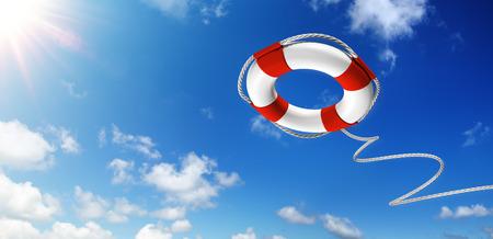 Het gooien van een reddingsboei in de lucht - Hulp Concept Stockfoto