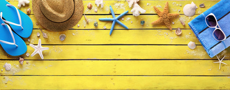 sunglasses beach: Beach Accessories On Yellow Wooden Plank - Summer Colors Stock Photo