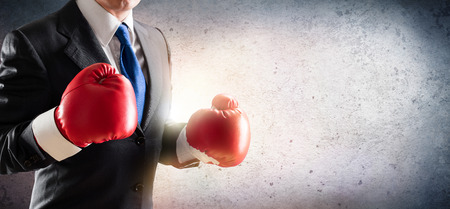power concept: Businessman In Boxing Gloves