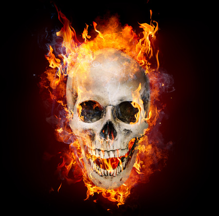Satanic Skull In Flames In The Darkness Stock Photo