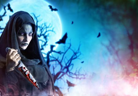 satanic: Murderer Woman With Bloody Knife In Satanic Halloween Night