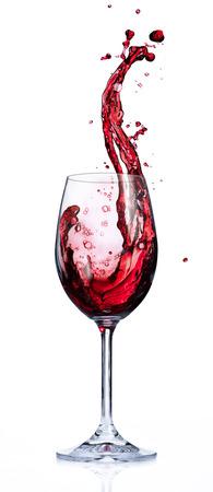 赤ワインのグラスの中で水しぶき 写真素材