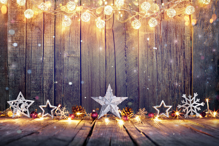 back light: Vintage Christmas Decoration With Stars And Lights On Wooden Table