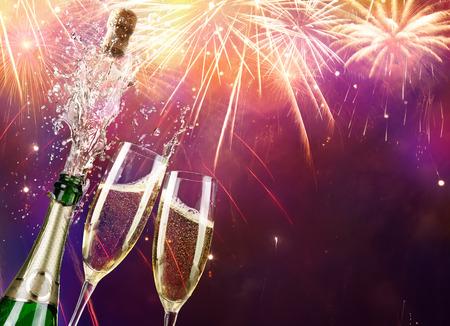 Champagne en een fles met Vuurwerk