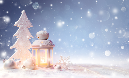 christmas candle: White Christmas Decoration With Lantern On Snowy Table And Shiny Snowfall