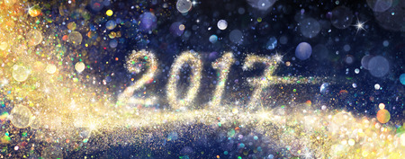 Happy New Year 2017 - With Glittering Golden Dust Stock Photo