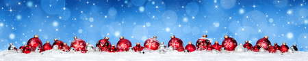 Red Baubles On Snow Whit Snowfall and Blue Heaven - Christmas Banner Stok Fotoğraf - 65624073