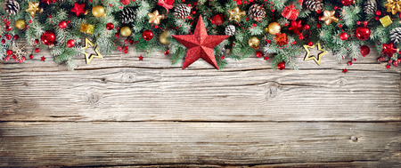Christmas Header - Border Of Fir Branches And Baubles On Old Wood Stock Photo - 65624075