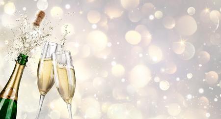 liquid splash: Champagne Explosion With Toast Of Flutes