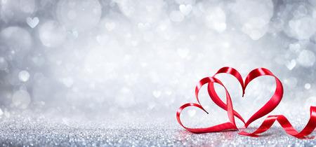 Valentines Day Decoration - Ribbon Shaped Hearts On Shiny Background Archivio Fotografico
