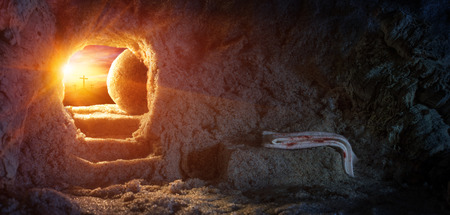 jesus: Empty Tomb With Shroud And Crucifixion At Sunrise - Resurrection Of Jesus Stock Photo