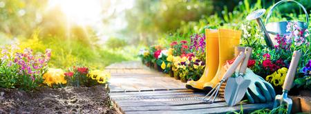 natures: Gardening - Set Of Tools For Gardener And Flowerpots In Sunny Garden