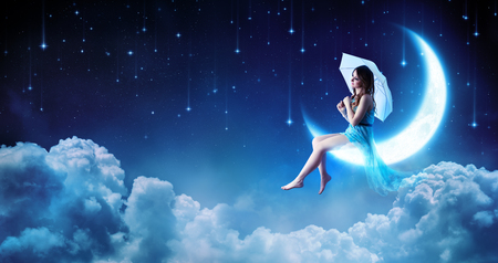 Dreaming In The Night Fantasy - Fashion Girl Sitting On Moon Stok Fotoğraf