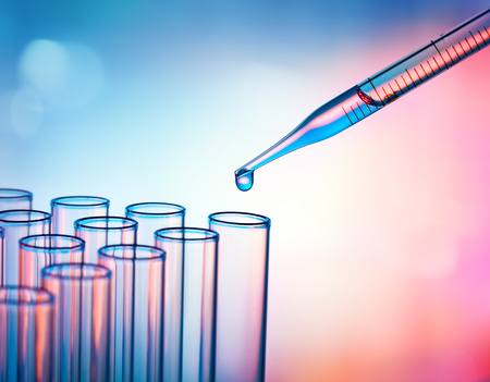 Pipette Dropping A Sample Into A Test Tube - Closeup