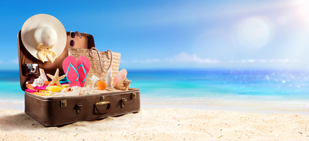 Beach Accessories In Suitcase On Beach - Travel Concept