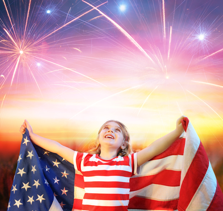 Little Girl With Usa Flag Celebrating Under Fireworks