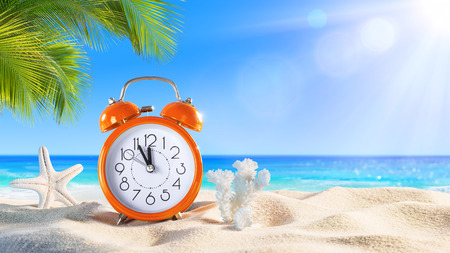 sand watch: Last Minute - Summertime Concept - Alarm In The Tropical Beach Stock Photo