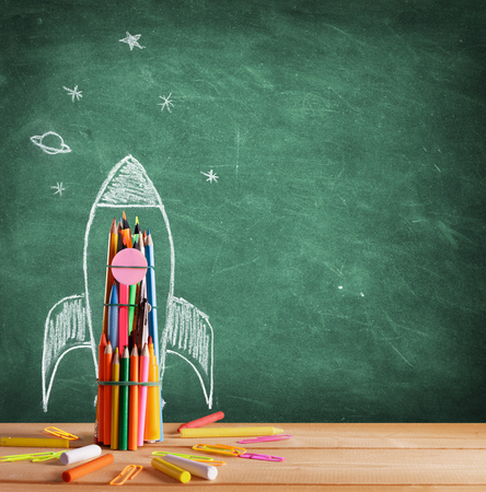 Back To School - Rocket Sketch On Blackboard Stockfoto