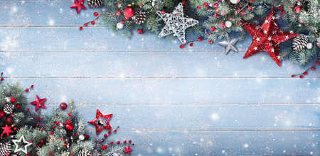 Christmas Background - Fir Branches And Baubles On Snowy Plank Stock Photo