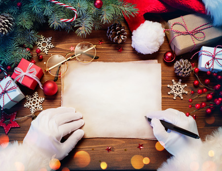 Santa Claus Desk With Letter And Christmas Present Stock Photo