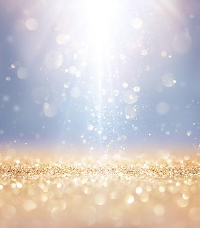 반짝이는 크리스마스 - 빛과 황금 반짝이에 떨어지는 별
