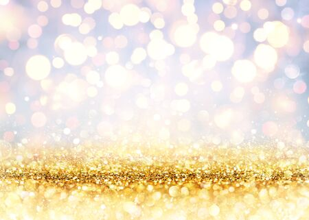 Golden Glitter On A Shiny Backdrop With Blurred Lights