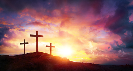 Crucifixion Of Jesus Christ At Sunrise - Three Crosses On Hill Stockfoto