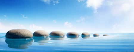 Step Stones In Blue Water - Zen Concept Stock Photo