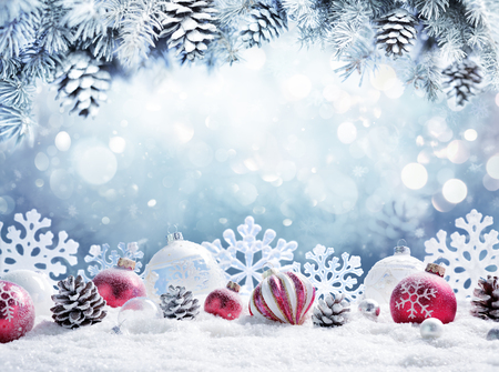 Christmas card - Baubles on snow with snowy fir branches Archivio Fotografico - 109803514