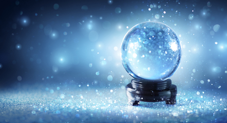 Snow Globe Sparkling In Shiny Background Stock Photo