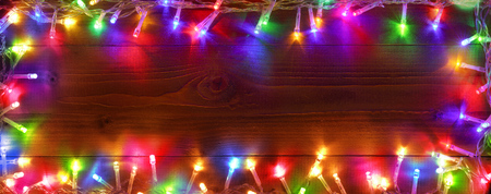 Colorful String Lights On Wooden - Christmas Frame Archivio Fotografico - 112126489