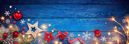 Christmas Ornament On Blue Table With String Light Archivio Fotografico - 112126506