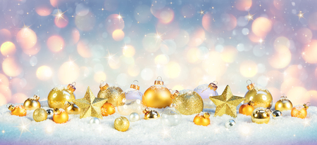 Christmas - Golden Baubles On Snow With Shiny Background Archivio Fotografico - 112126613